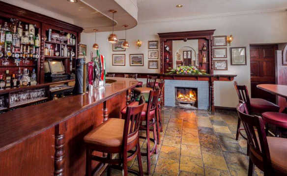 Open peat fire burning in the bar at the Breffni Arms Hotel, Arva/