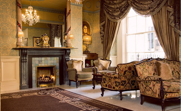Elegant lounge with open fire at the Buswells Hotel, Dublin/