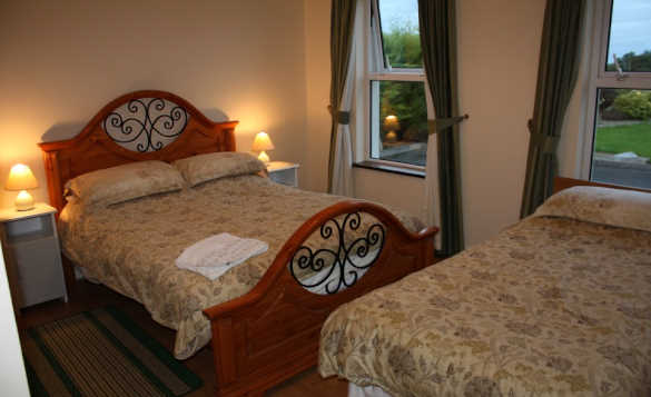 Bedroom with two double beds at Cassidy's self-catering cottages, Ballyconnell/