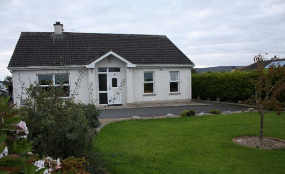 Single storey white two bedroom cottage at Cassidy's self-catering cottages, Ballyconnell/