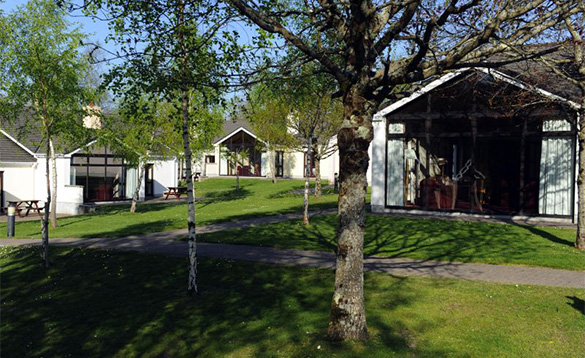 Woodland Lodges self-catering cottages set amongst trees at the Castlerosse Hotel in Killarney /