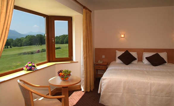 Double bedroom at the Castlerosse Hotel in Killarney with views across a golf course to the Magillycuddy Mountains/