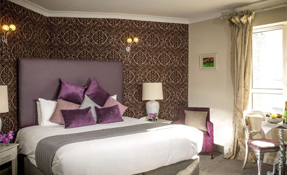 Guest bedroom with double bed at the Celtic Ross Hotel in Co Cork/
