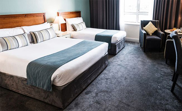 Guest bedroom with double and single bed at the Celtic Ross Hotel in Co Cork/