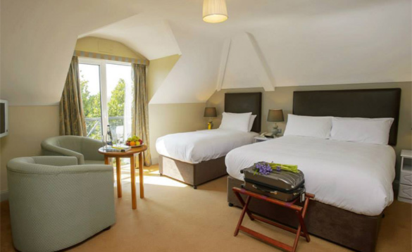 Bedroom at the Hylands Burren Hotel in Ballyvaughan, Co Clare with double and single bed/