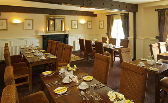 Dining room at the Hylands Burren Hotel in Ballyvaughan, Co Clare with tables set for dinner/
