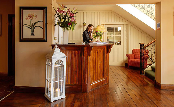 Receptionist answering a phone in the reception of the Hylands Burren Hotel in Ballyvaughan, Co Clare/