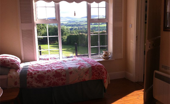 Bedroom with single bed and views over the Wicklow Mountains/