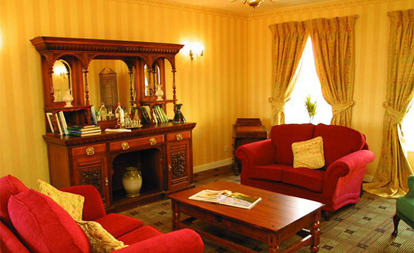 Lounge at Sheedys Hotel, Lisdoonvarna with two red sofas either side of coffee table/