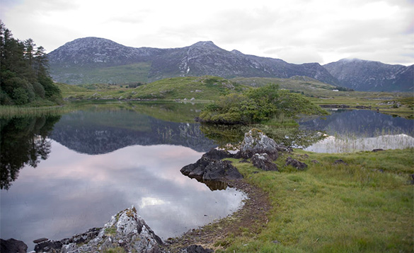 Mountains reflected in a lake in Connemara, Co Galway/