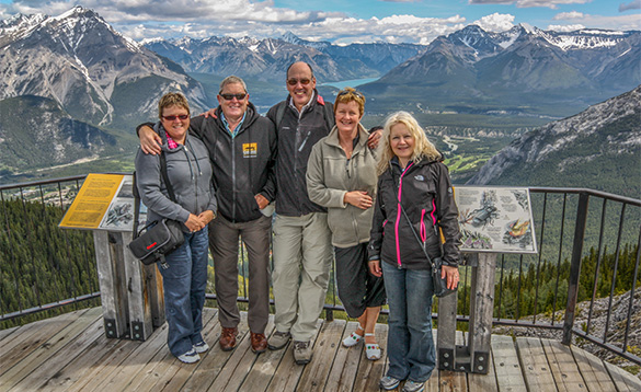 group of people on a viewing platform looking out over the Canadian Rocky mountains/