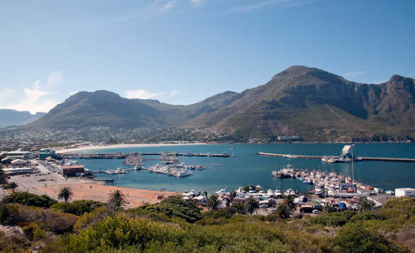 View across Hout Bay Harbour to mountains in Cape Town, South Africa/