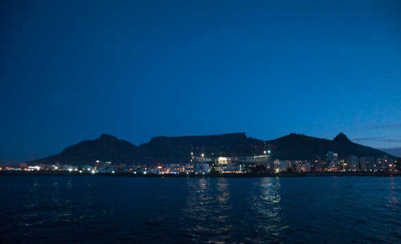 Nighttime view across water towards Table Top Mountain, Cape Town/
