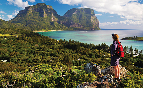 Hiker walking along the coast in Australia/