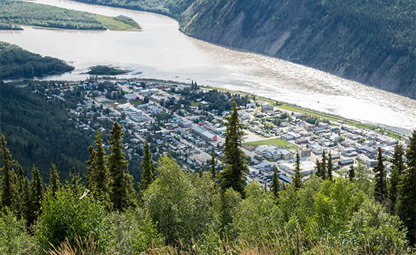 River flowing past a town in the Yukon/