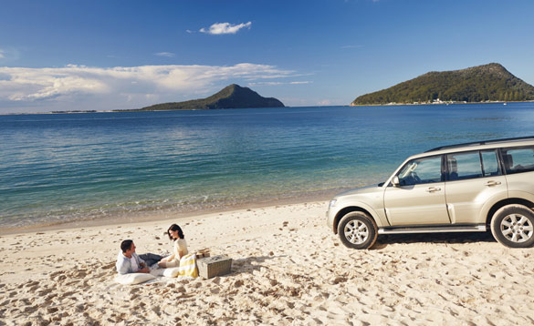 Couple enjoying a picnic on a beach in Australia/