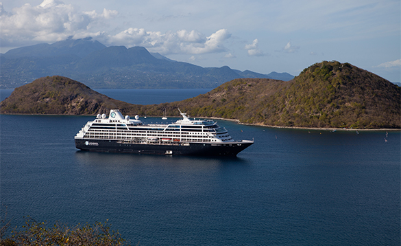 Azamara Quest cruise ship at sea cruising past islands/