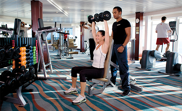 People working out in the gym on an Azamara cruise ship/