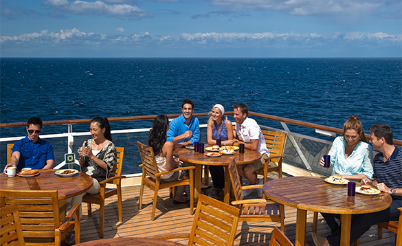 Passengers dining on the Aft deck onboard Celebrity Constellation cruise ship/