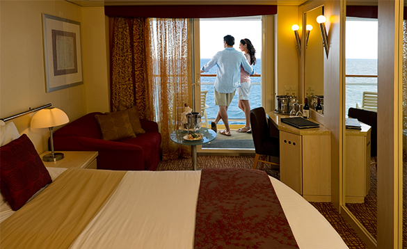 Couple on the balcony of a Stateroom cabin on Celebrity Constellation cruise ship/
