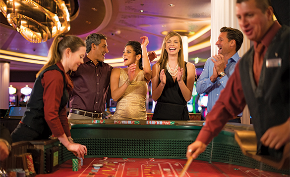 Passengers enjoying a night in the casino on a Celebrity Cruises ship/