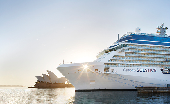 Celebrity Solstice cruise ship moored in Sydney harbour with the Sydney Opera House in the background/