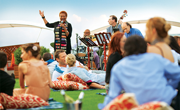 Passengers enjoying the Lawn Club band on Celebrity Silhouette/