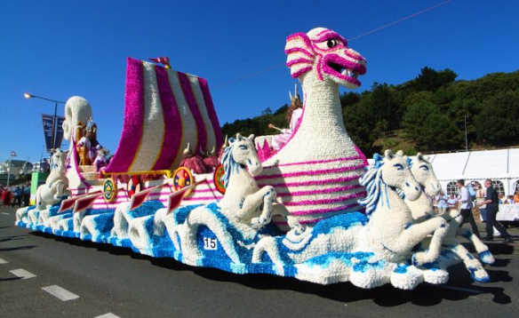 Float decorated in flowers to represent a boat at sea in the Battle of the Flowers Day Parade in Jersey/