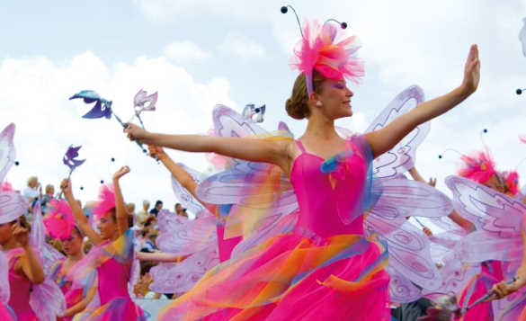 Ladies dressed in pink with wings to represent fairies in the Battle of the Flowers Day Parade, Jersey/