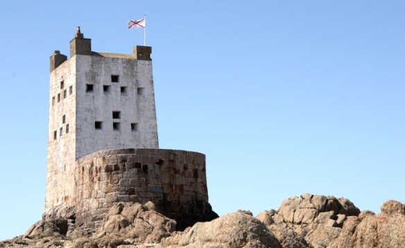 White tower of Seymour Tower a coastal defence tower built on a rocky tidal island called L'Avarison, located close to Jersey/