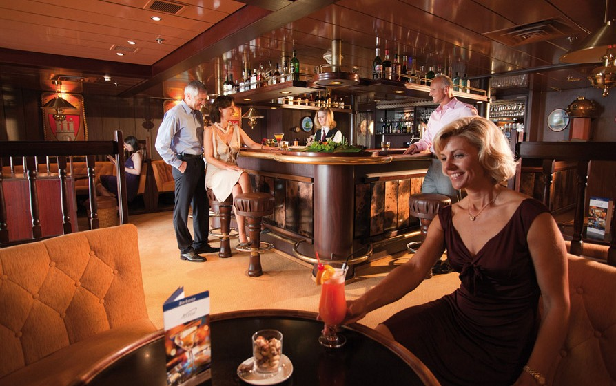 Passengers enjoying drinks in the Hanse Bar on the Cruise and Maritime ship Astor/
