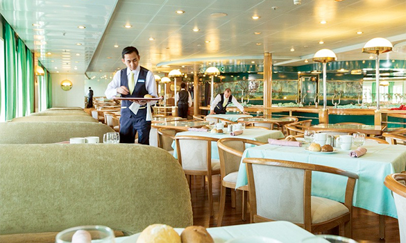 Waiters setting tables in the Lotus Buffet restaurant on the Cruise and Maritime ship Astoria/