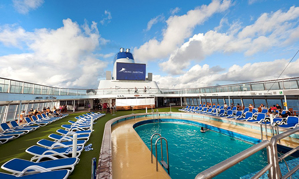 Passengers on loungers by the pool on the Cruise and Maritime ship Columbus/