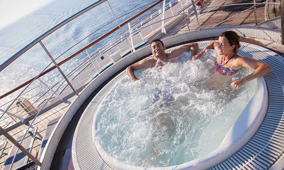 Couple relaxing in the whirlpools on the Cruise and Maritime ship Magellan/