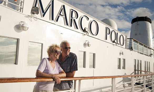 Couple standing on the deck of the Cruise and Maritime ship Marco Polo/