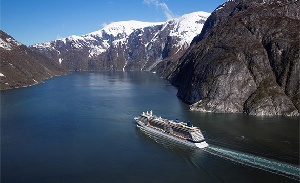 Cruise ship heading up a fjord in Norway/
