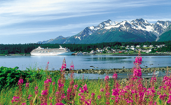 Crystal Cruises ship moored by snow capped mountains in Alaska/