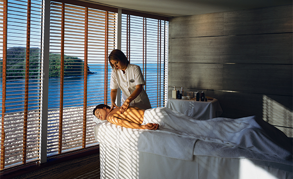 Lady enjoying a back massage in the Spa onboard a Crystal cruises ship/