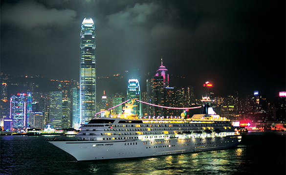 Crystal Cruises ship moored in Hong Kong at night/