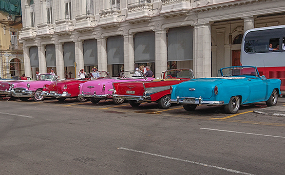 Cars parked outside a building in Havana, Cuba/