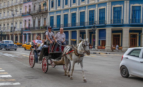 Group of people enjoying a horse and carriage ride through Havana, Cuba/
