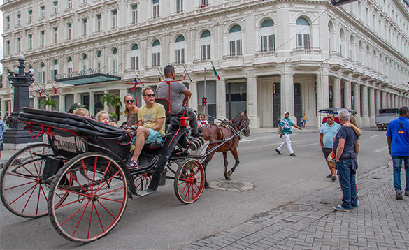 Family enjoying a horse and carriage ride in Havana, Cuba/