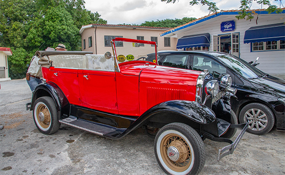 Old red convertible car in Cuba/
