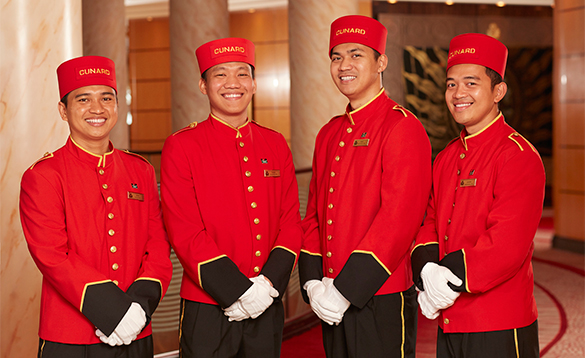 Cunard's bellboys in scarlet uniforms/