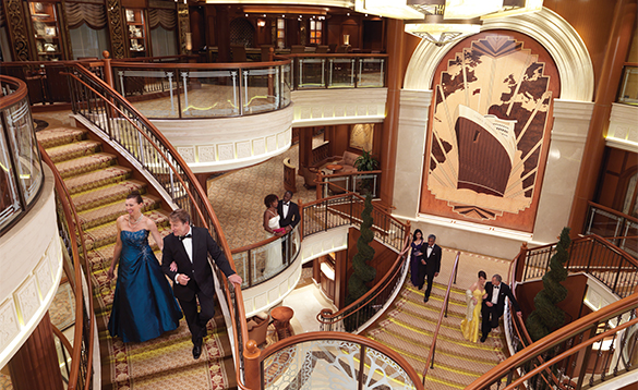 Passengers dressed in evening wear in the Grand Lobby of Queen Elizabeth cruise ship/