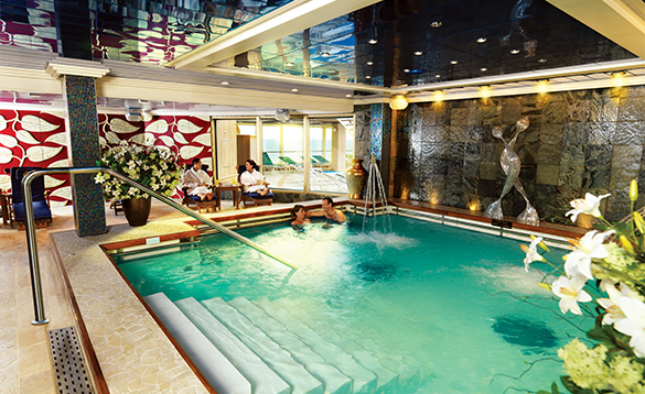 People relaxing in the Hydropool onboard Queen Victoria cruise ship/
