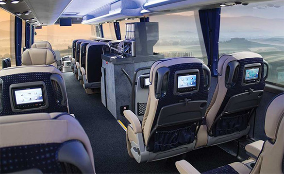 Leger holidays luxury coach interior with comfortable seats with TVs in headrests/