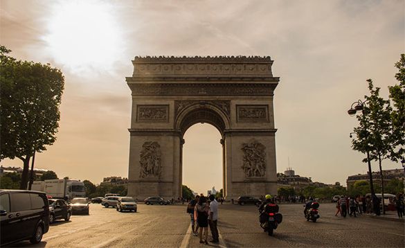 Tourists admiring the Arc De Triomphe in Paris/
