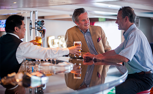 Two gentlemen enjoying a pint in the Lido lounge on Fred Olsen cruise ship Boudicca/