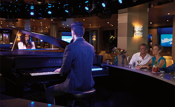 Passengers listening to a pianist in the Billboard Bar onboard a Holland America cruise ship/